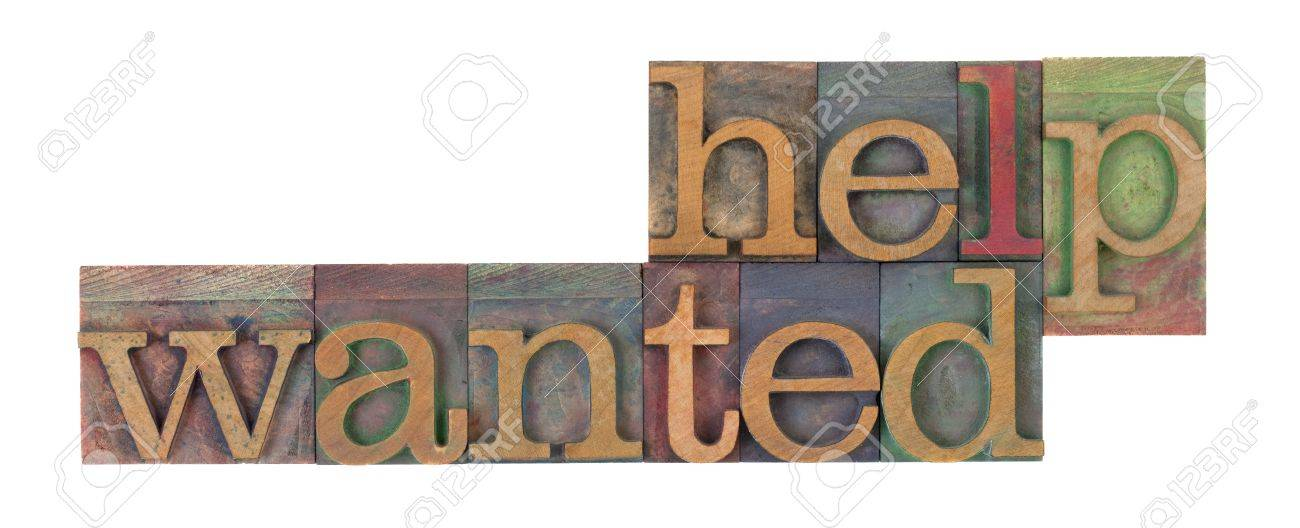 help wanted words in vintage wooden letterpress printing blocks, stained by color inks, isolated on white Stock Photo - 7459061