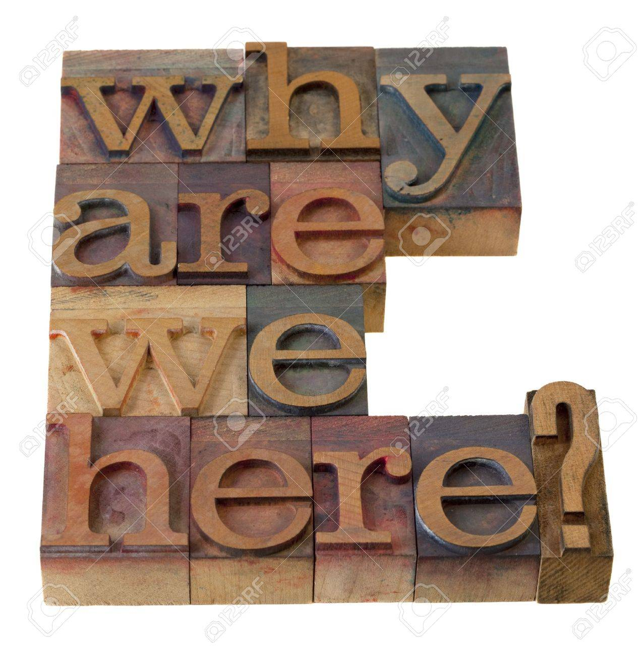 philosophical question, why are we here , in vintage wooden letterpress printing blocks, stained by color inks, isolated on white Stock Photo - 7543887