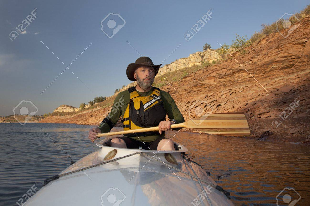 mature adult paddler in an expedition decked canoe on calm mountain lake (Horsetooth Reservoir near Fort Collins, Colorado) Stock Photo - 7908029