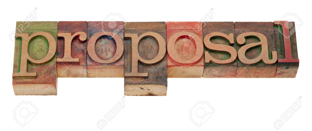 proposal word in vintage wooden letterpress printing blocks, stained by color inks, isolated on white Stock Photo - 8612727