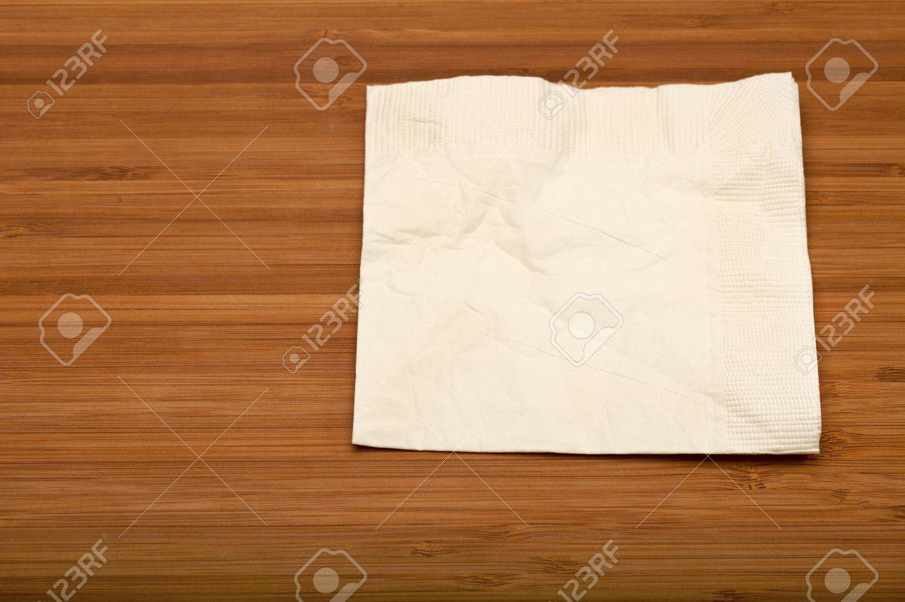 beige cocktail napkin on wooden (Bamboo) table Stock Photo - 8797517