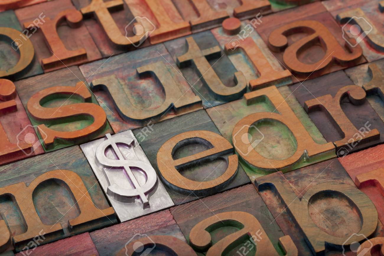 metal dollar sign among vintage wooden letterpress printing blocks - financial concept Stock Photo - 8801393