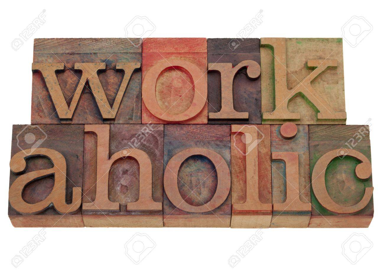a compulsive worker concept, workaholic word in vintage wooden letterpress printing blocks, stained by color inks, isolated on white Stock Photo - 8797513