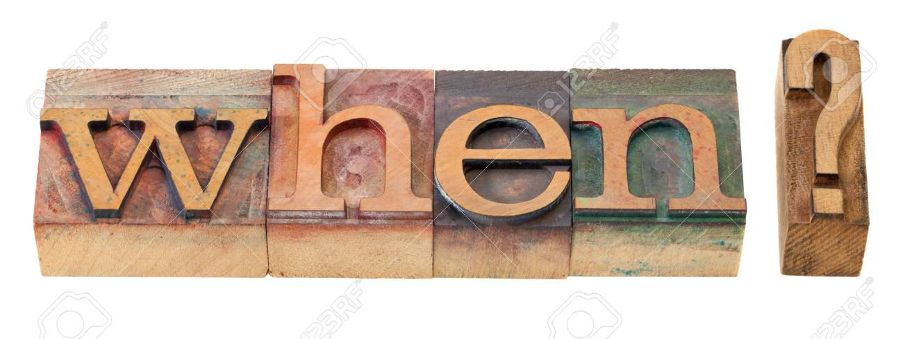 when question in vintage wood letterpress printing blocks, stained by color inks Stock Photo - 8801419