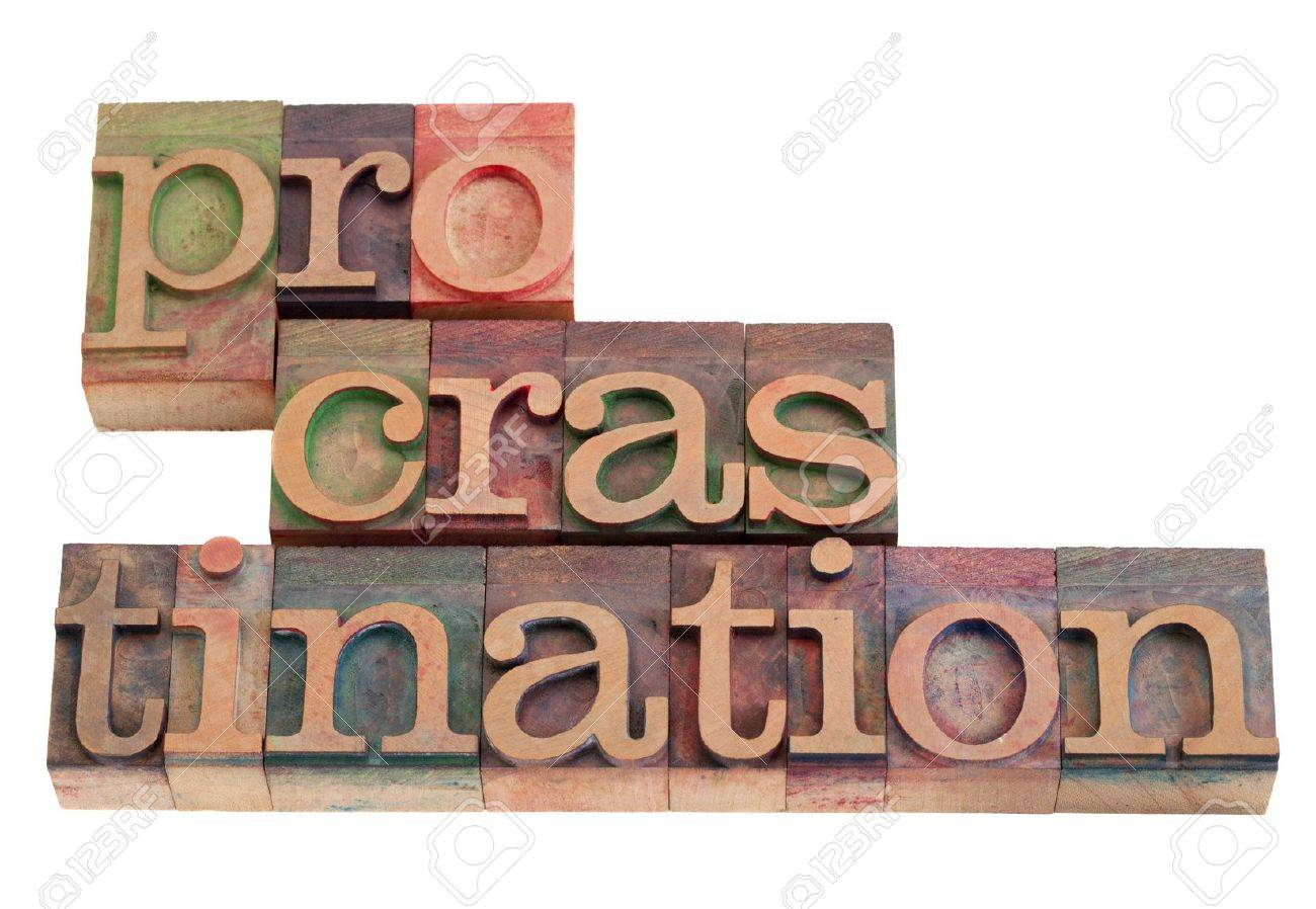 procrastination word abstract in vintage wooden letterpress printing blocks, stained by color inks, isolated on white Stock Photo - 8908217