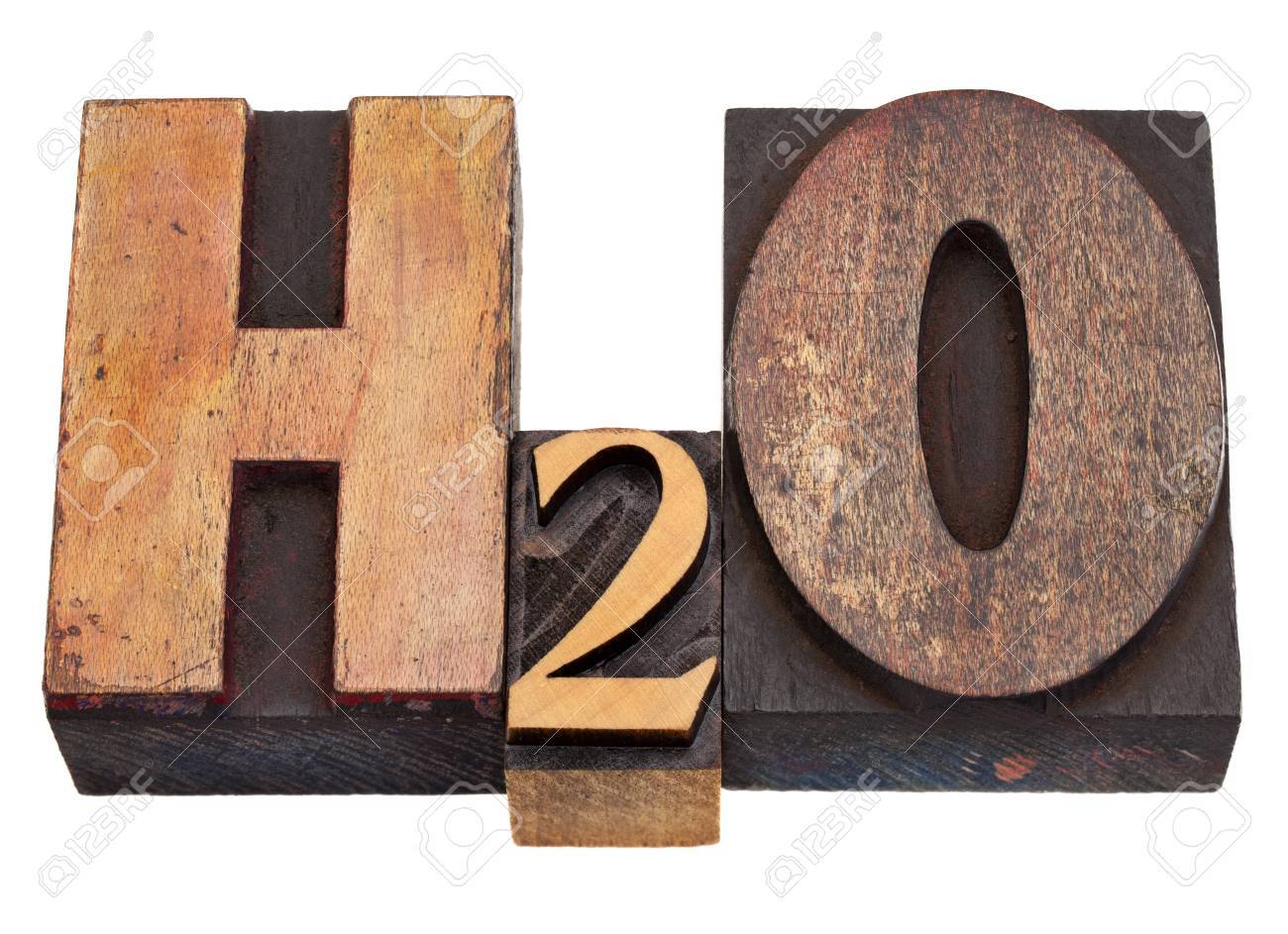 H2O - water chemical symbol in vintage wood letterpress printing blocks, stained by color inks, isolated on white Stock Photo - 8987628