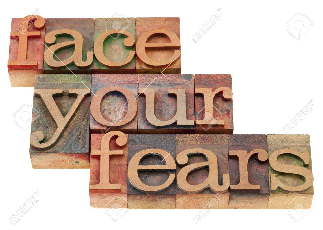 face your fears phrase in vintage wood letterpress printing blocks, isolated on white Stock Photo - 9157428