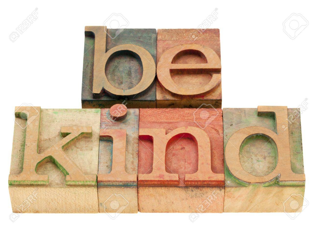 be kind motivational reminder - phrase in vintage wood letterpress type, stained by color inks, isolated on white Stock Photo - 9215222