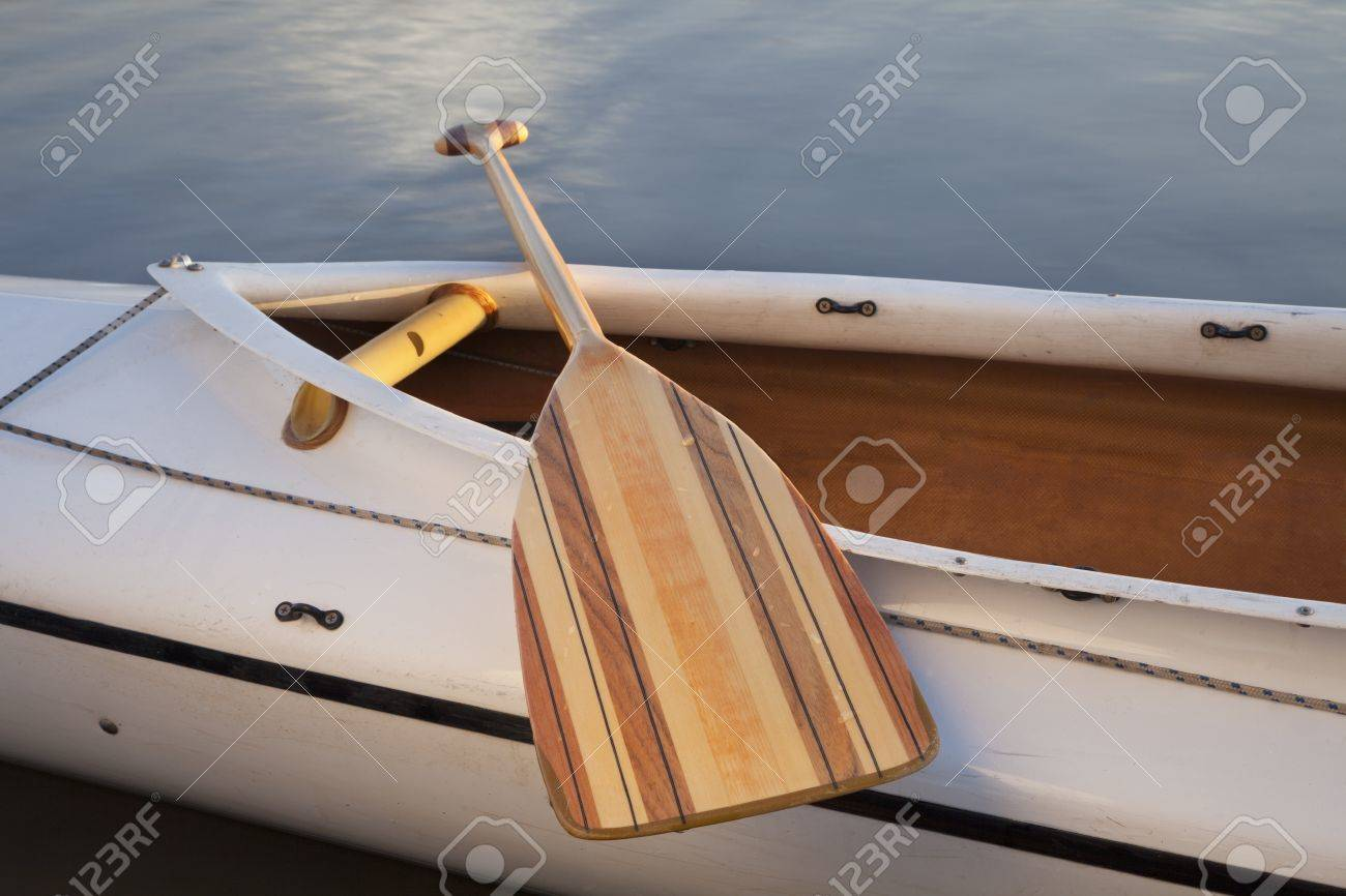 a wooden paddle across cockpit of decked expedition canoe Stock Photo - 9215231
