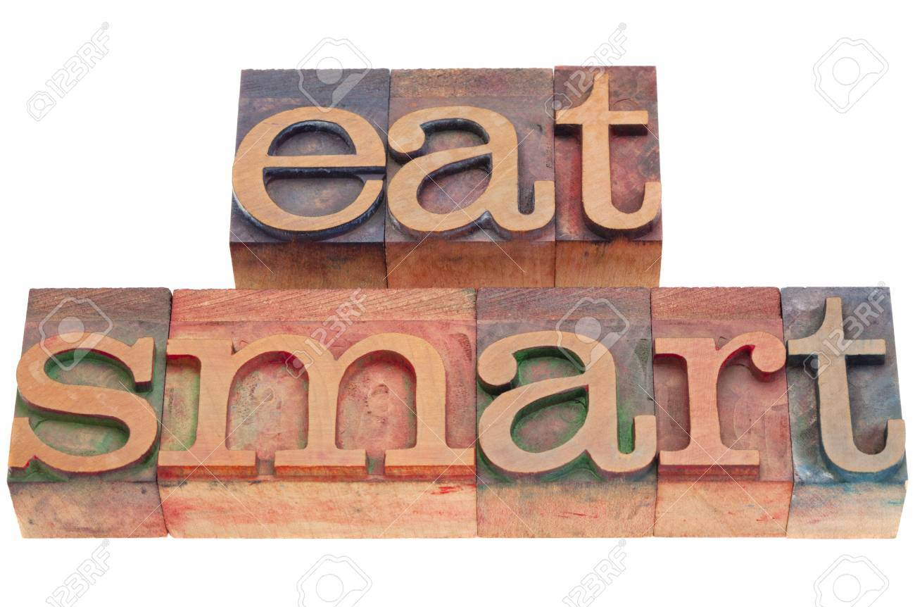 diet concept - eat smart phrase in vintage wood letterpress printing blocks isolated on white Stock Photo - 9283779