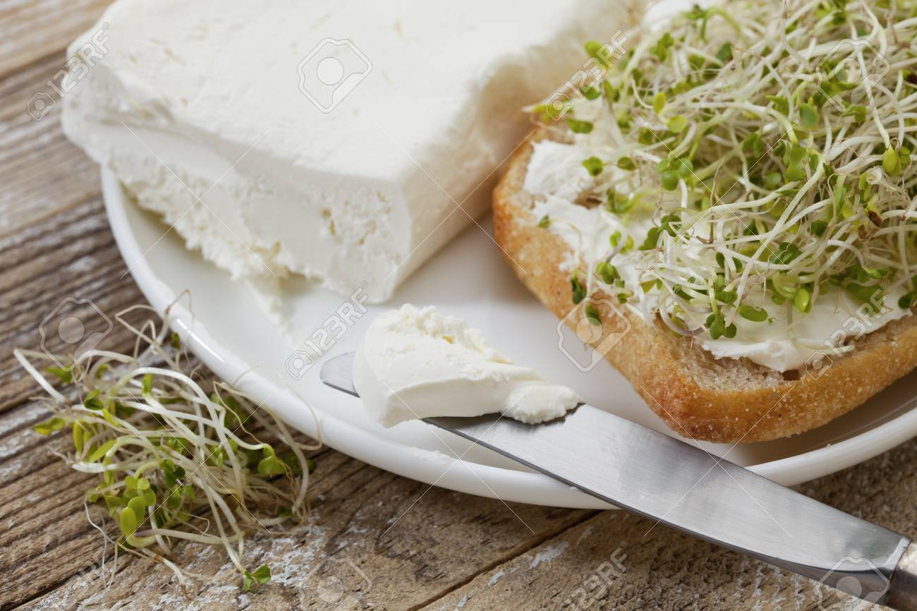 healthy breakfast concept - a roll with cream cheese and broccoli sprouts Stock Photo - 9335150