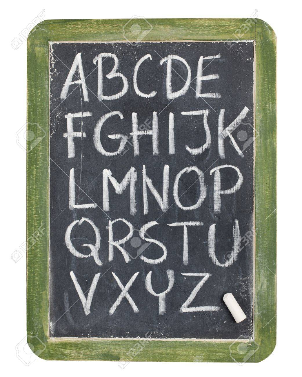 English alphabet - rough handwriting with white chalk on old slate blackboard, isolated on white Stock Photo - 9387541