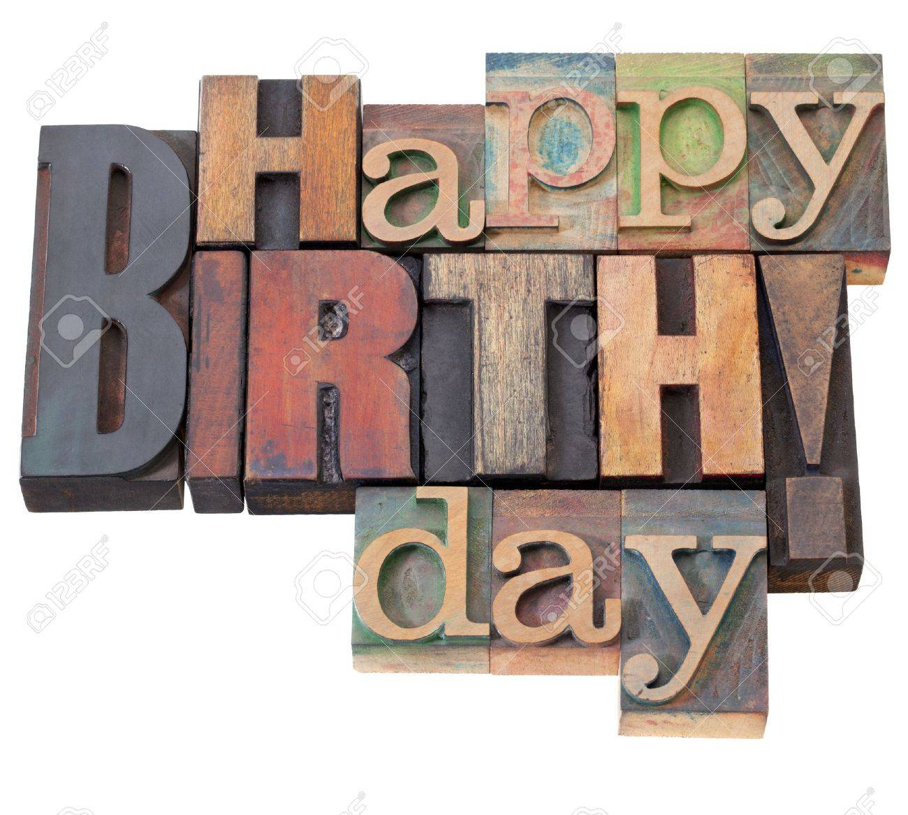 Happy Birthday in antique wood letterpress printing blocks, isolated on white Stock Photo - 9441832