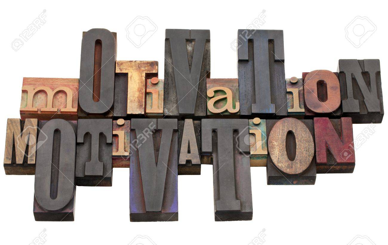motivation word abstract - antique wood letterpress printing blocks of different size and style isolated on white Stock Photo - 9529111