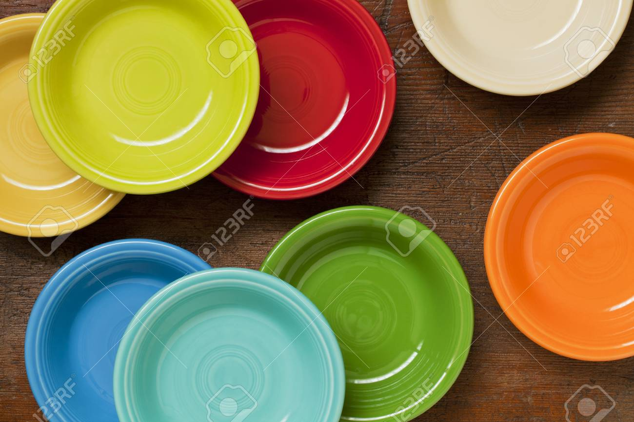 colorful ceramic bowls on a grunge weathered wood background - top view Stock Photo - 9739557