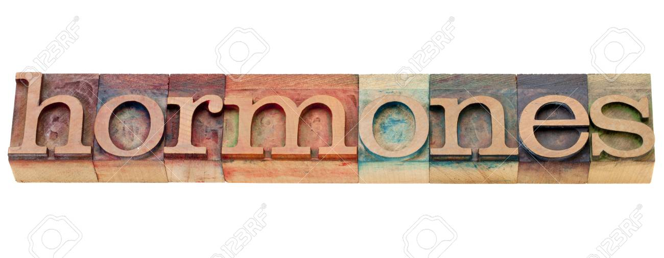 hormones -  health concept - isolated word in vintage wood letterpress printing blocks stained by color inks Stock Photo - 10493244