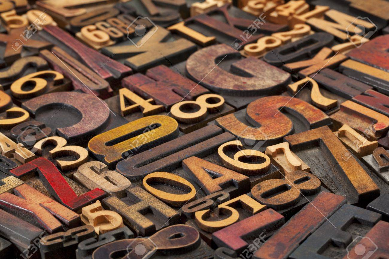 random letters and numbers in antique wood letterpress printing