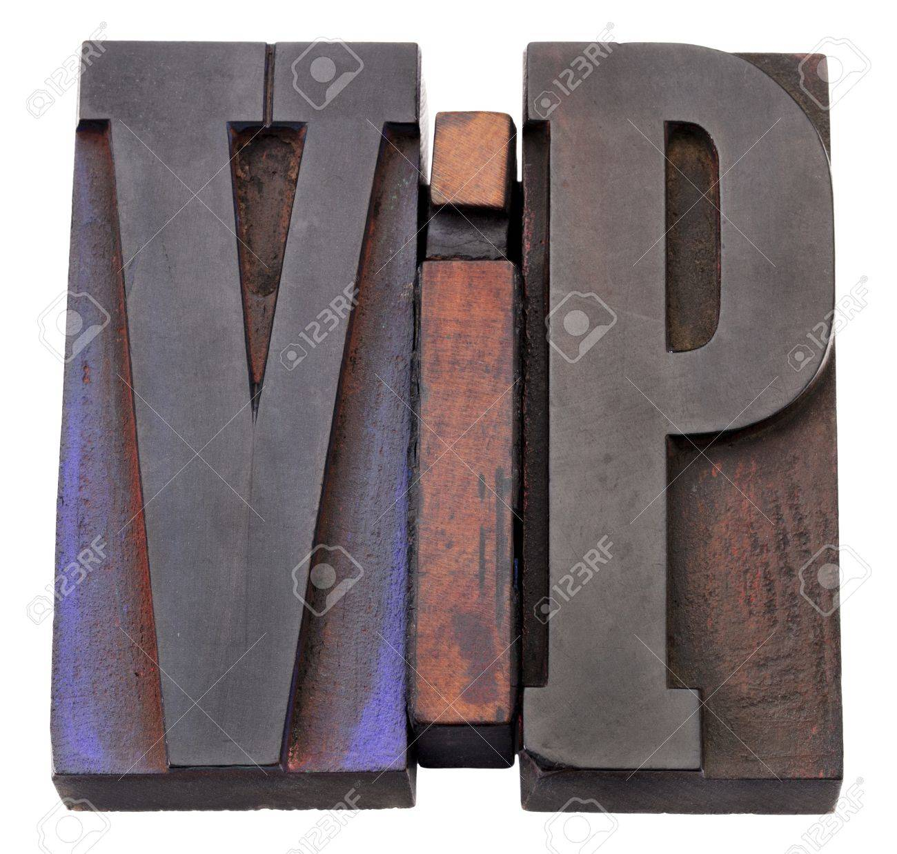 VIP (very important person)  acronym - isolated vintage wood letterpess printing blocks stained by color inks Stock Photo - 11279647