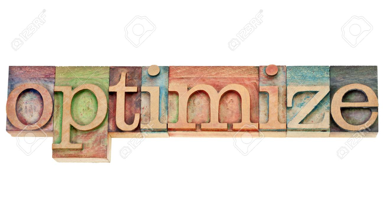 optimize - isolated word in vintage wood letterpress printing blocks stained by colorful inks Stock Photo - 12114960