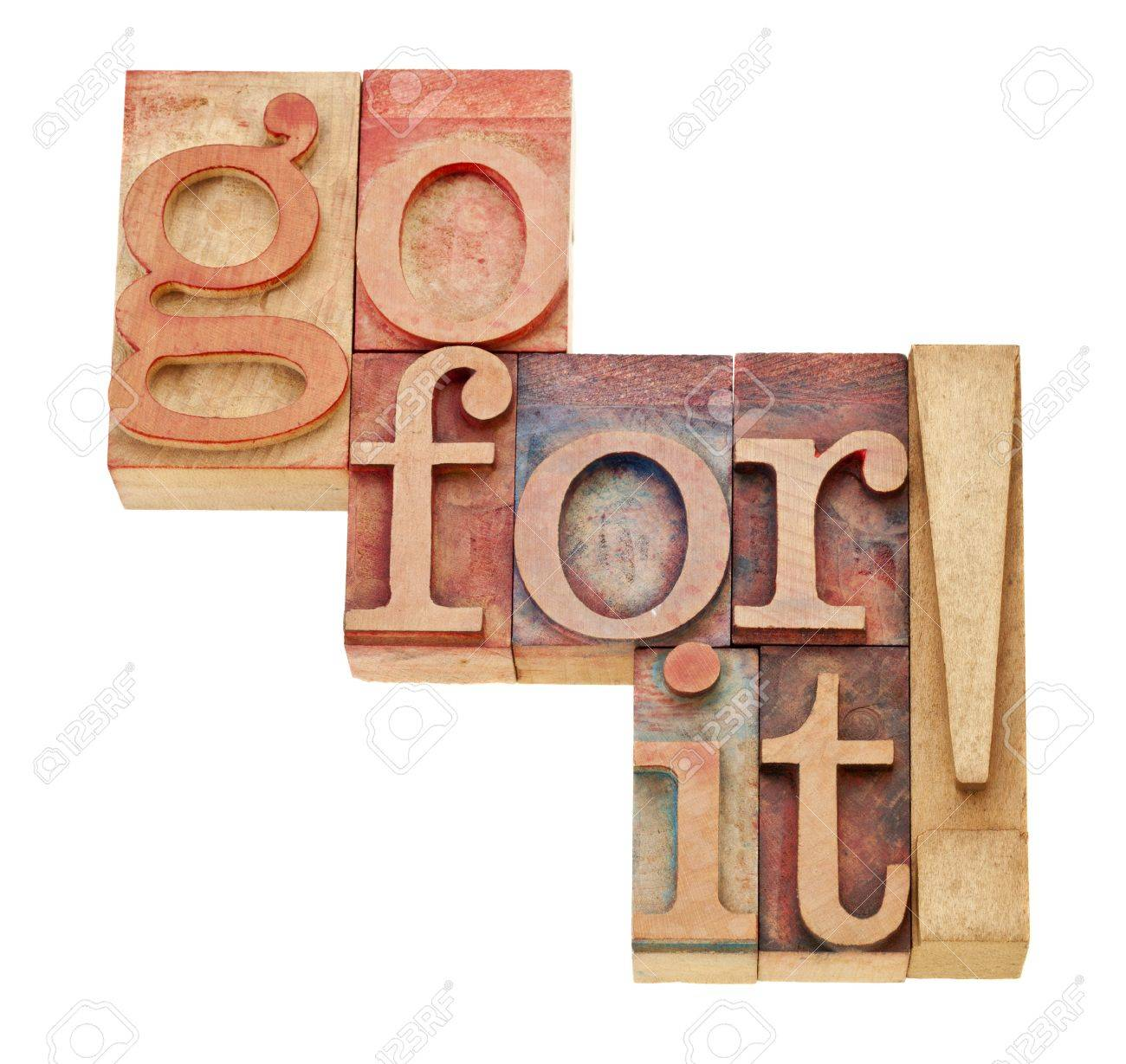 go for it - motivation concept - isolated words in vintage wood letterpress printing blocks Stock Photo - 12114984