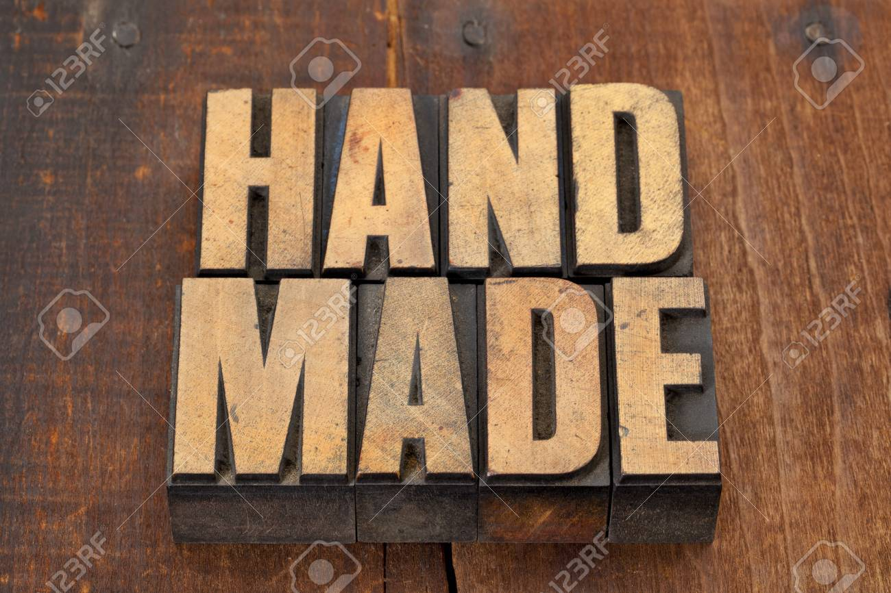 handmade word in vintage letterpress type on grunge wooden background with nails Stock Photo - 12871301