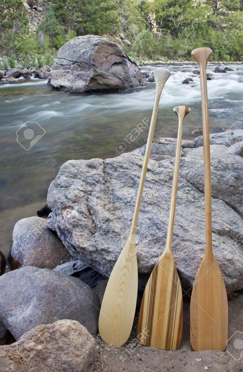three wooden canoe paddles on shore of mountain river - Cache la Poudre RIver near Fort Collins, Colorado Stock Photo - 13227070