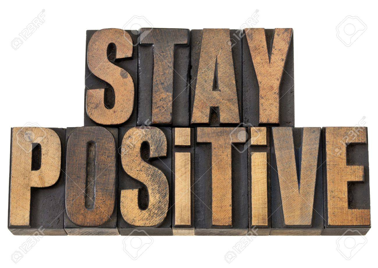 stay positive - motivation concept - isolated text in vintage letterpress wood type Stock Photo - 13559122