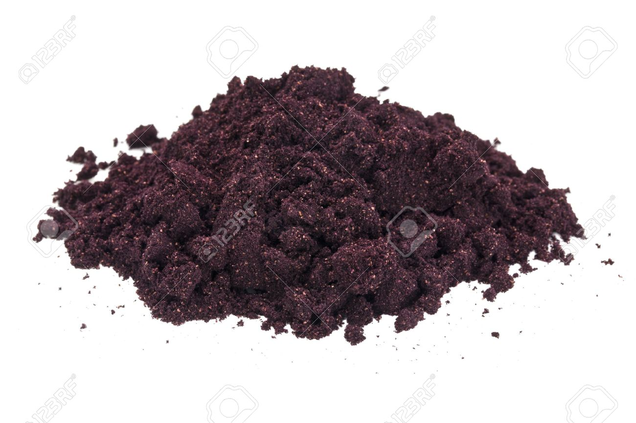 a pile of organic freeze-dried maqui fruit (Aristotelia Chilensis) powder isolated on white Stock Photo - 13968446