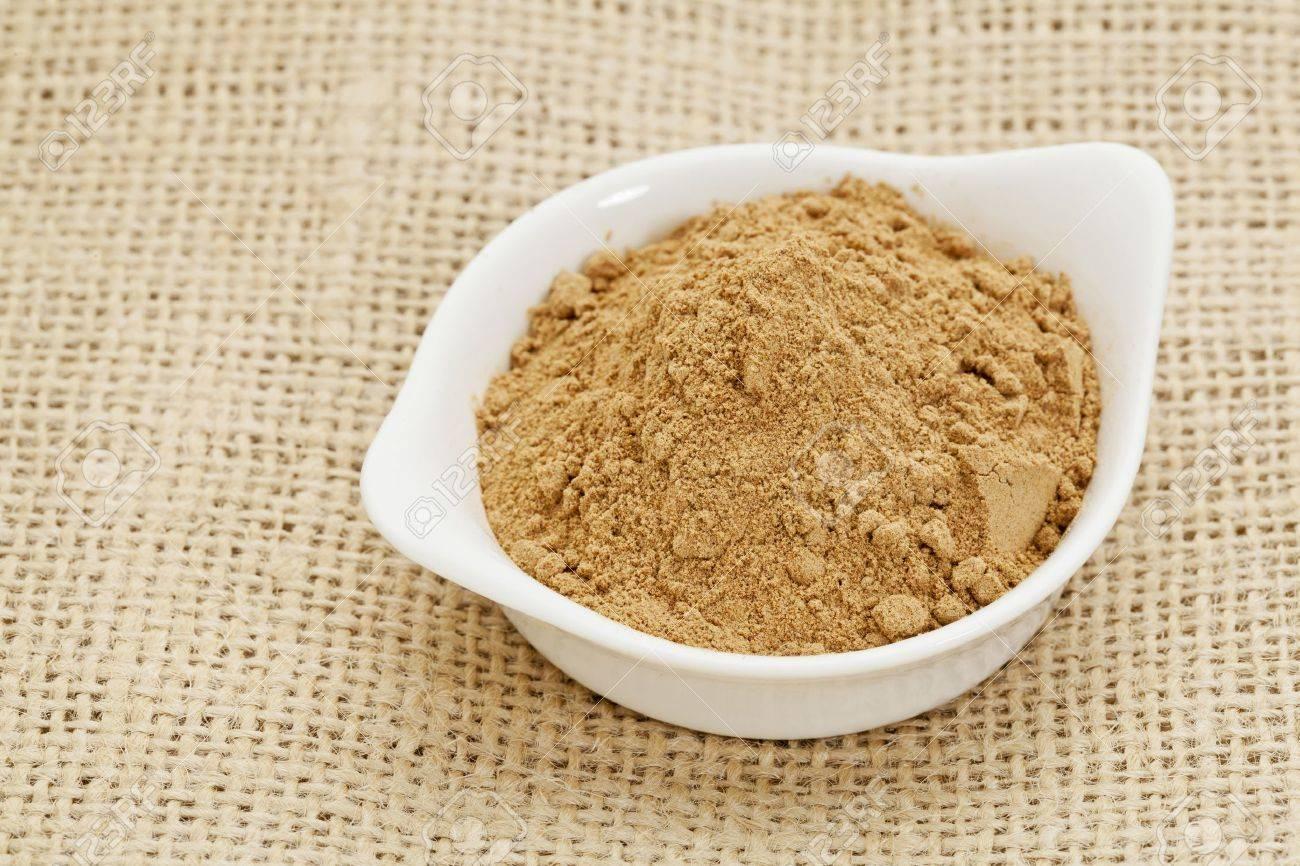 raw organic dried camu camu fruit powder  Myciara Dubia  in a small ceramic bowl - rainforest superfruit from Peru rich in vitamin C Stock Photo - 14007148