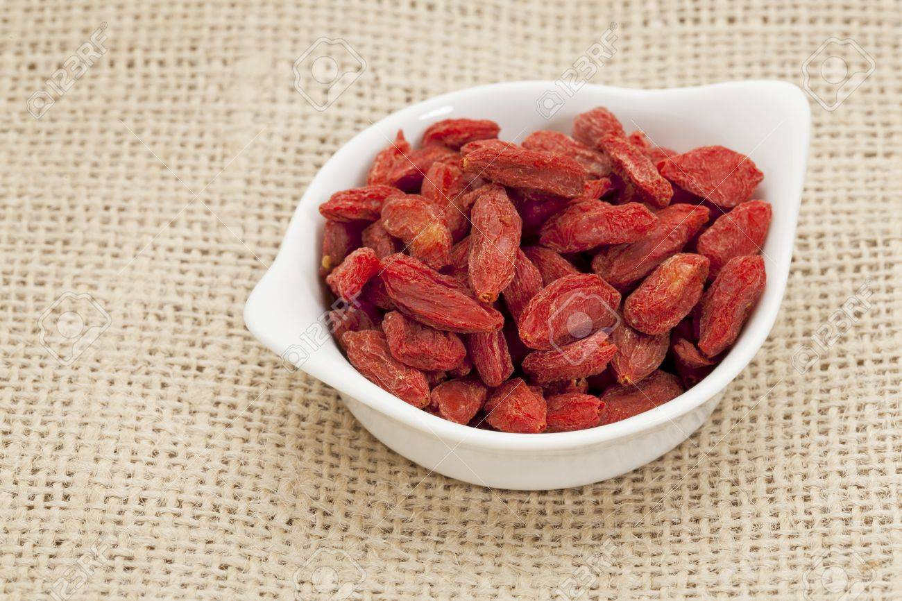 organic goji berries  wolfberry  in a small ceramic bowl - HImalayan superfood Stock Photo - 14007146