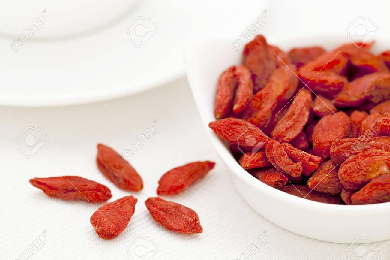 organic dried goji berries (wolfberry) in a small ceramic bowl - Tibetan superfood Stock Photo - 14167348