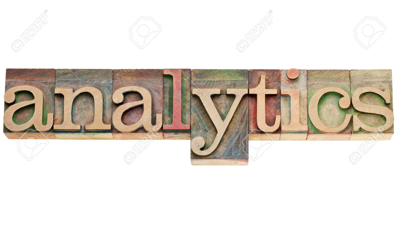 analytics  - isolated word in vintage letterpress wood type stained by color inks Stock Photo - 14968428