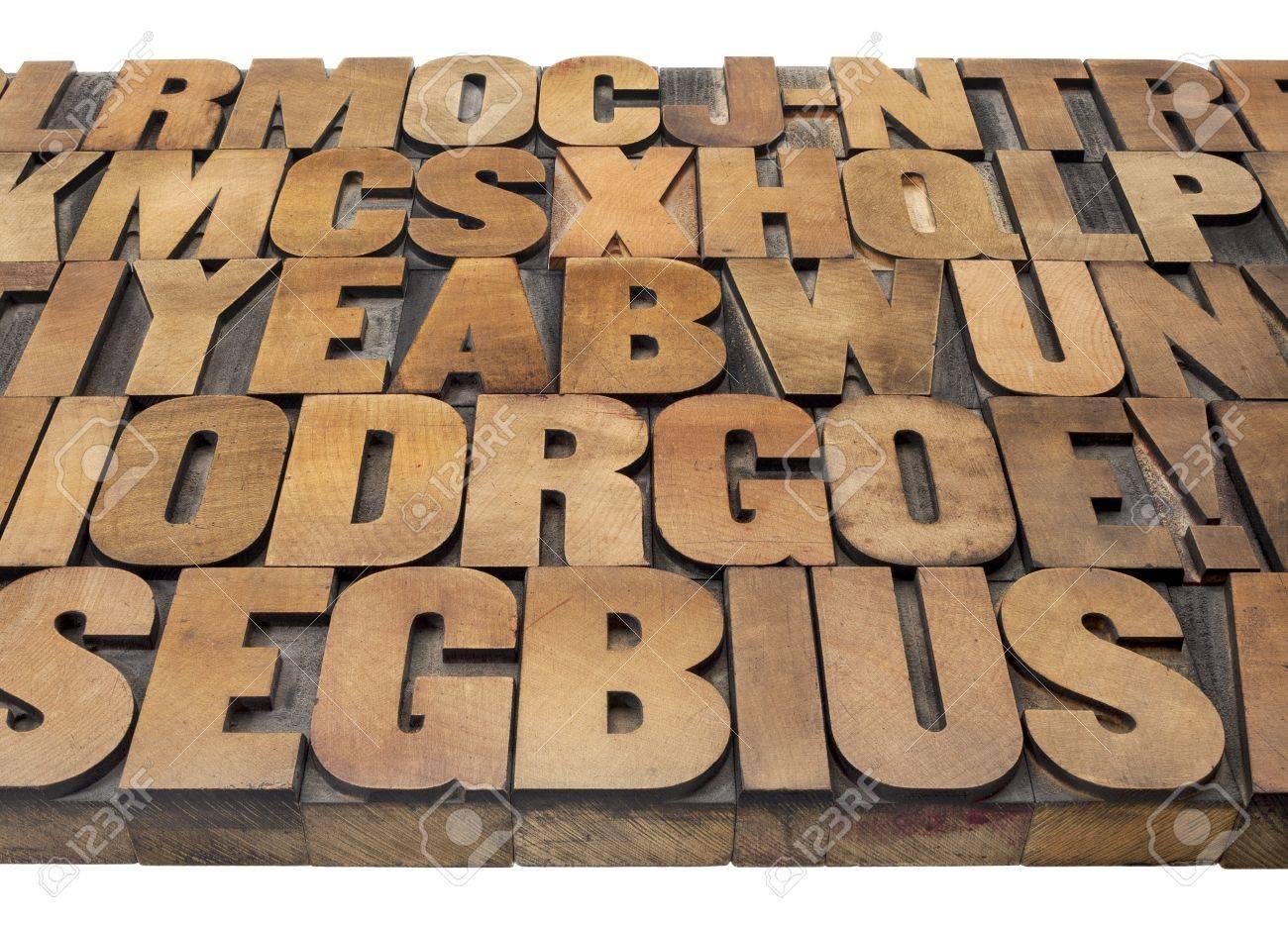 alphabet abstract - vintage letterpress wood type printing blocks isolated on white Stock Photo - 15488389