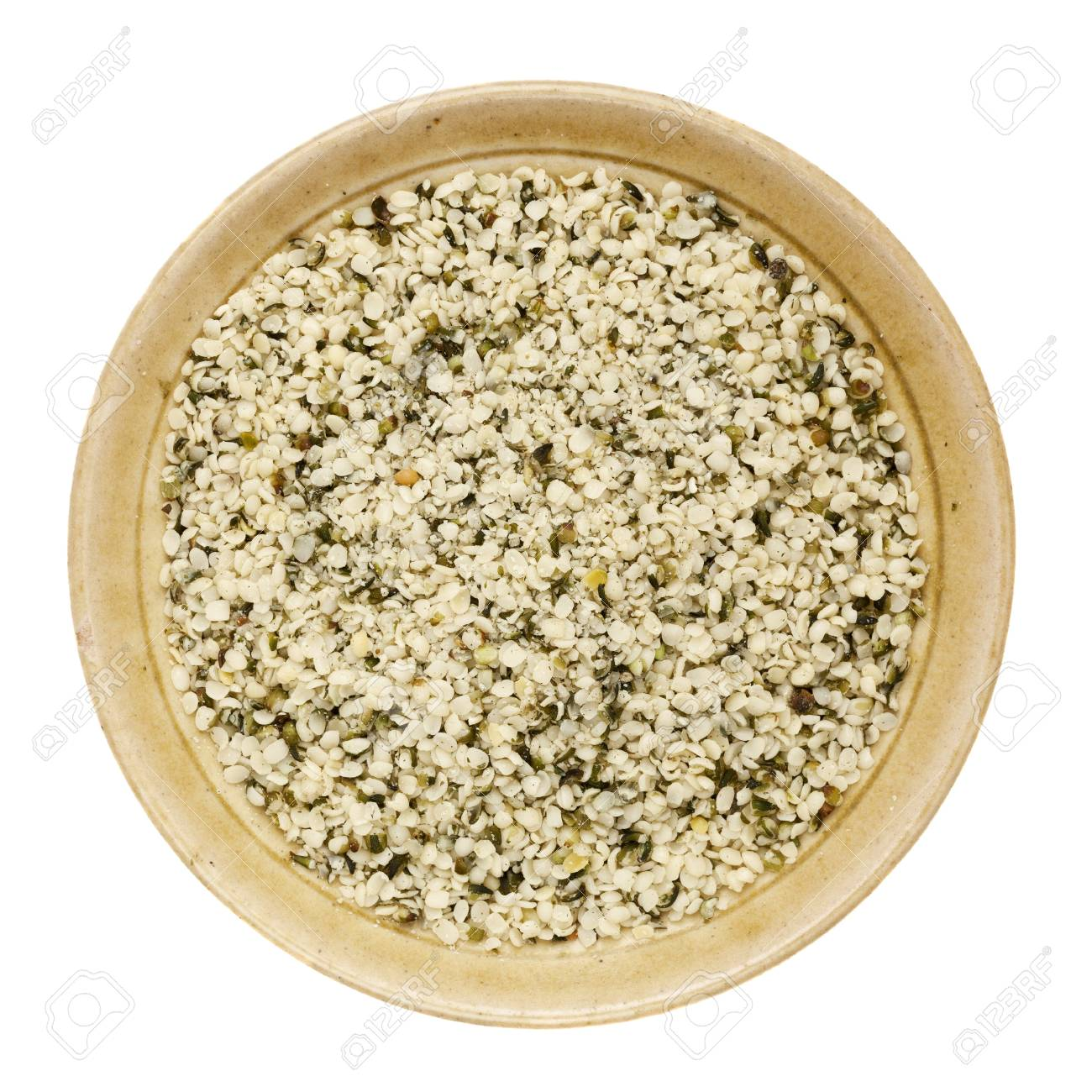 shelled hemp seeds in a round ceramic bowl isolated on white Stock Photo - 15488391