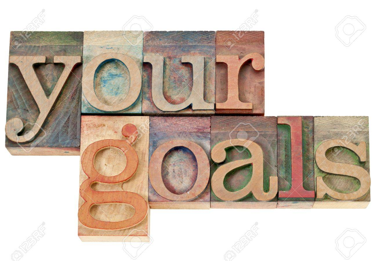 your goals - isolated words in vintage letterpress wood type stained by color inks Stock Photo - 15499369