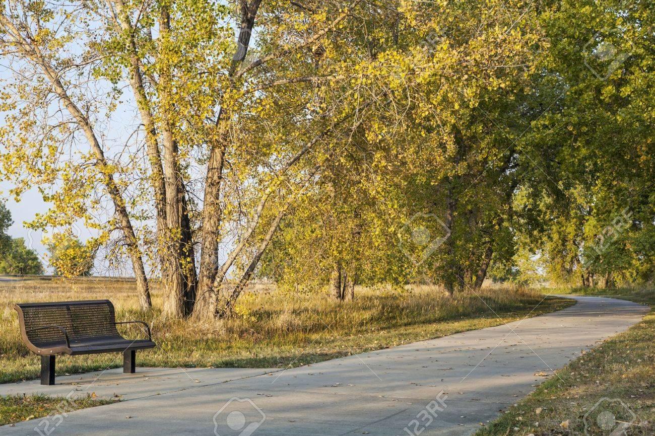 bench and recreational biking trail in Boyd Lake State Park near Loveland, Colorado, fall scenery Stock Photo - 15523499