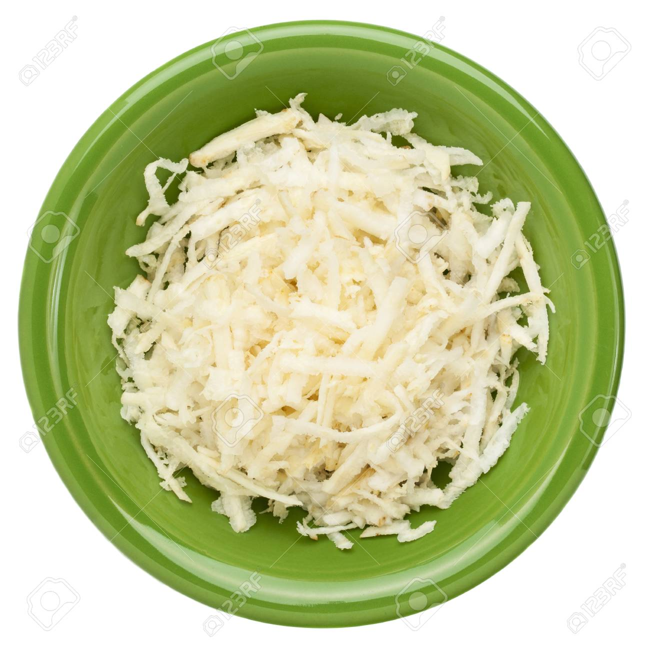 grated celery root  celeriac  on a small green ceramic bowl, isolated on white Stock Photo - 15776575
