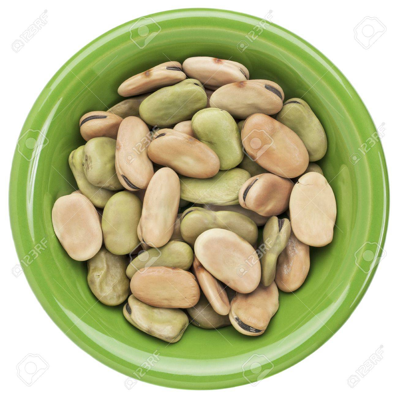 dried fava (broad) bean in a small ceramic bowl isolated on white Stock Photo - 15887236