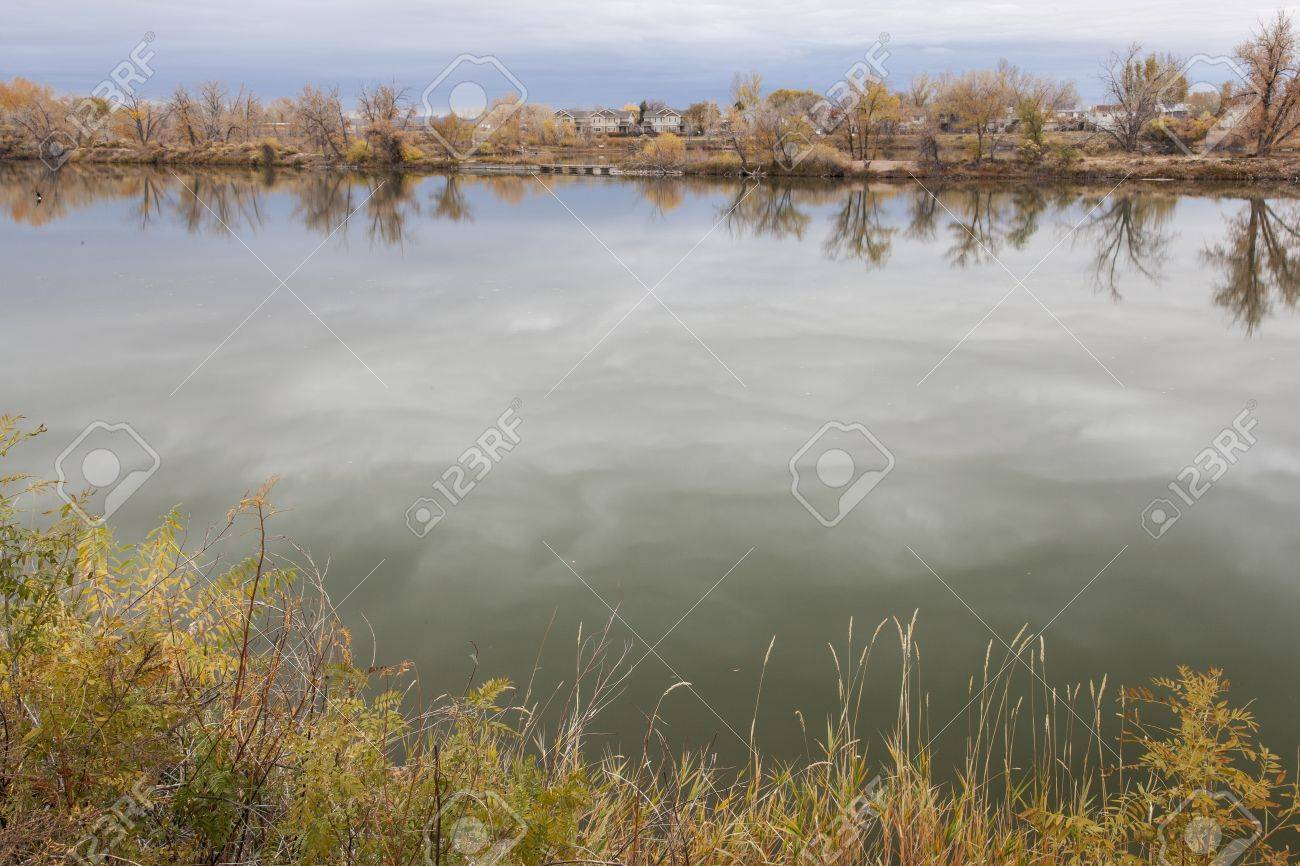 gravel pit converted into natural area - Riverbend Ponds, Fort Collins, Colorado in late fall scenery with residential homes in background Stock Photo - 15934814