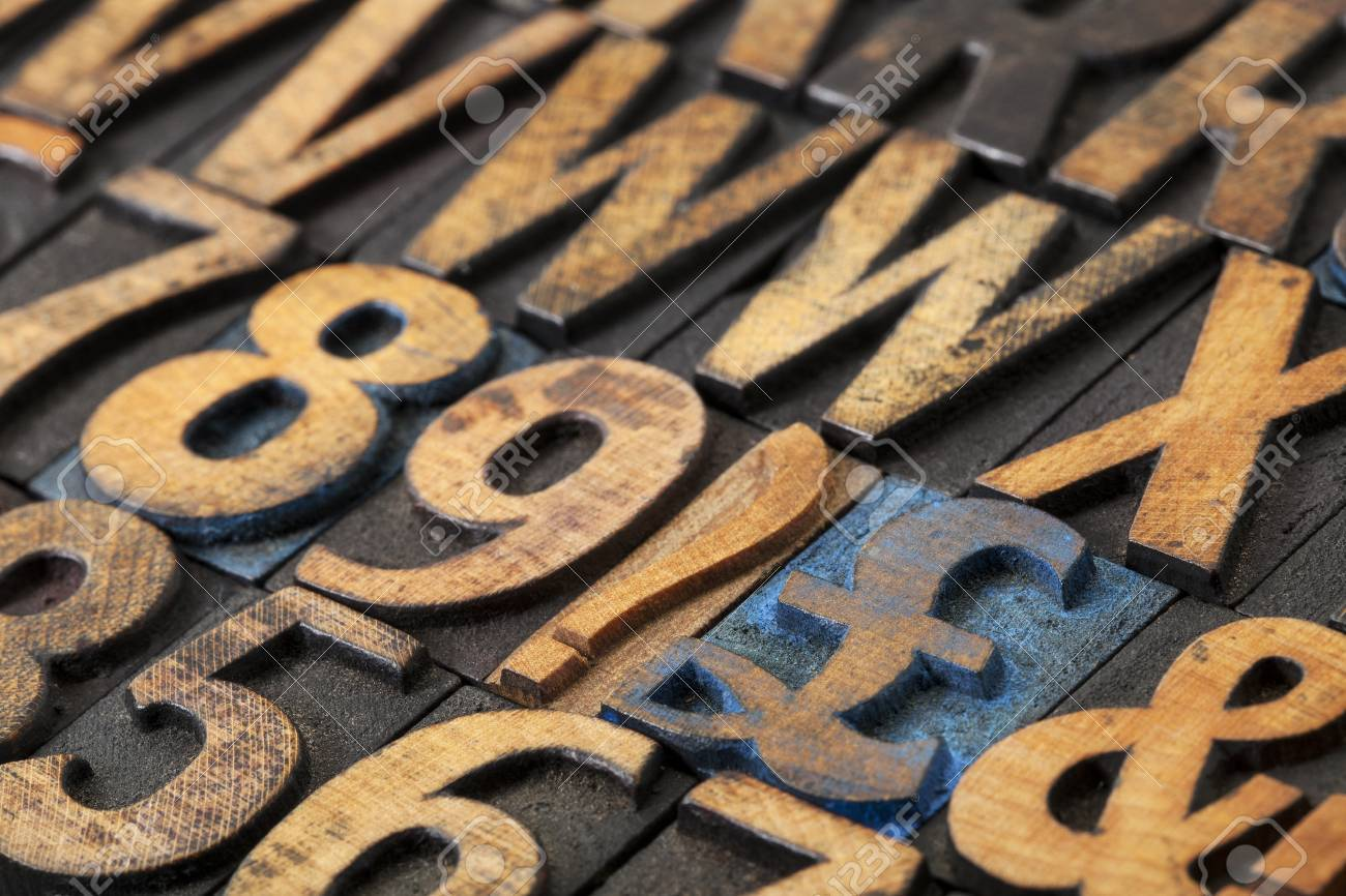pound symbol among vintage letterpress  wood type blocks, selective focus Stock Photo - 16429844