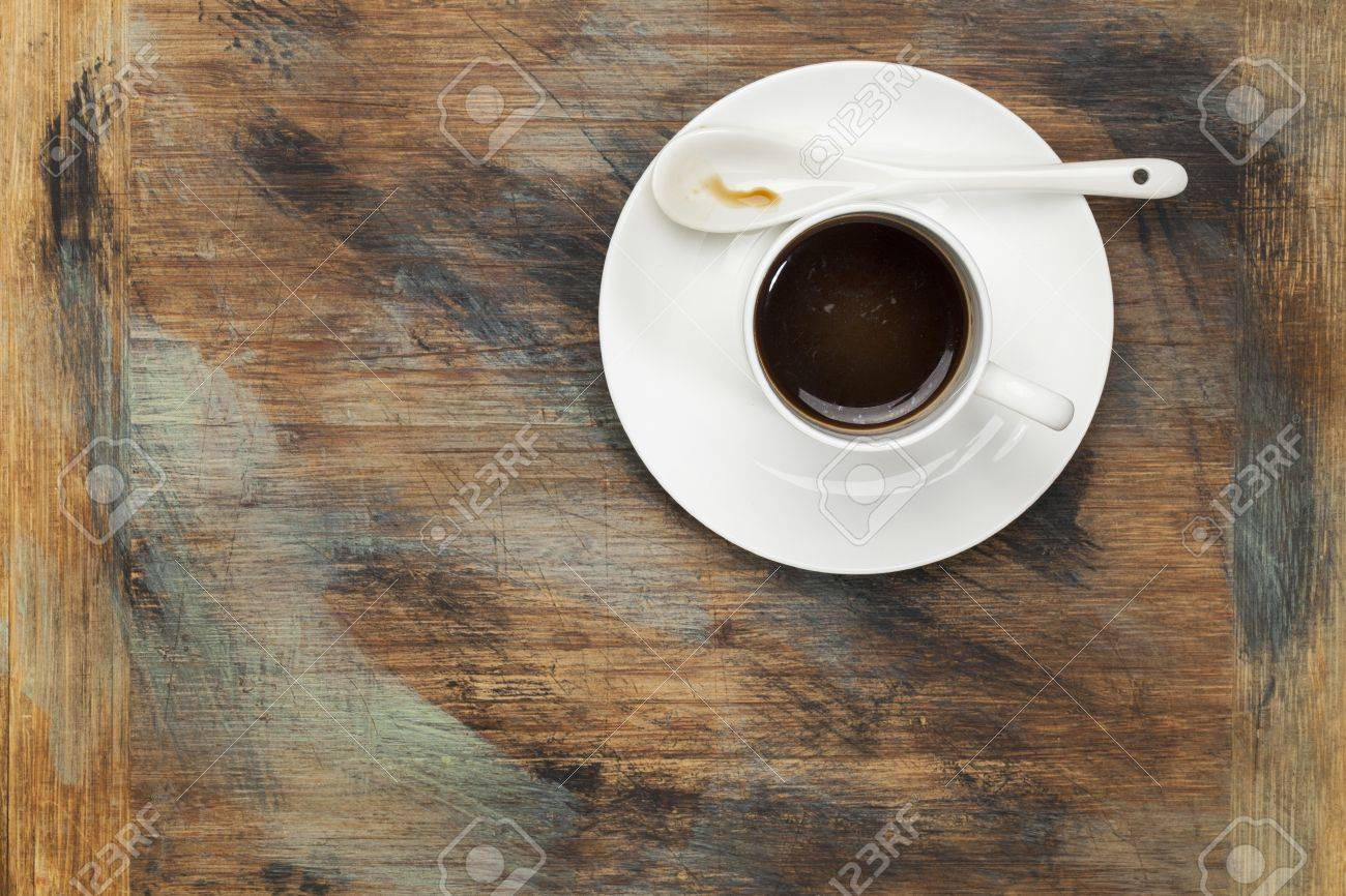 cup of black coffee on grunge painted wood table Stock Photo - 16645598
