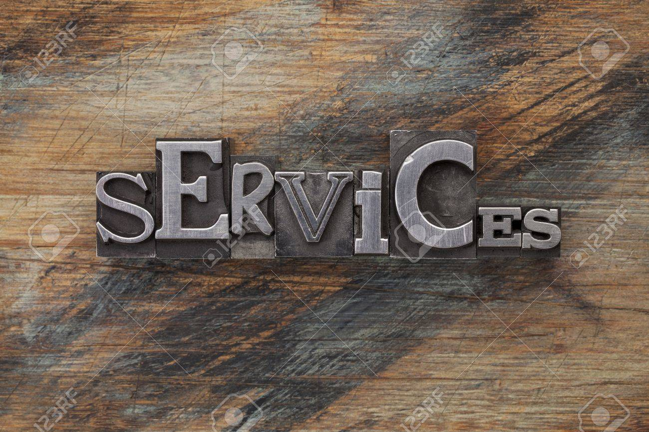 services - word in vintage letterpress metal type blocks on a grunge painted wood Stock Photo - 16645610