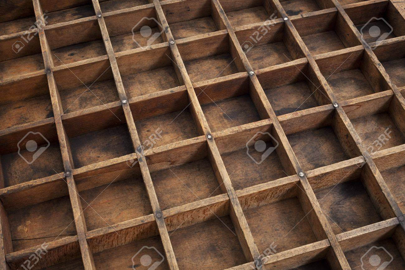 detail of vintage grunge wood typesetter drawer with dividers Stock Photo - 16770340