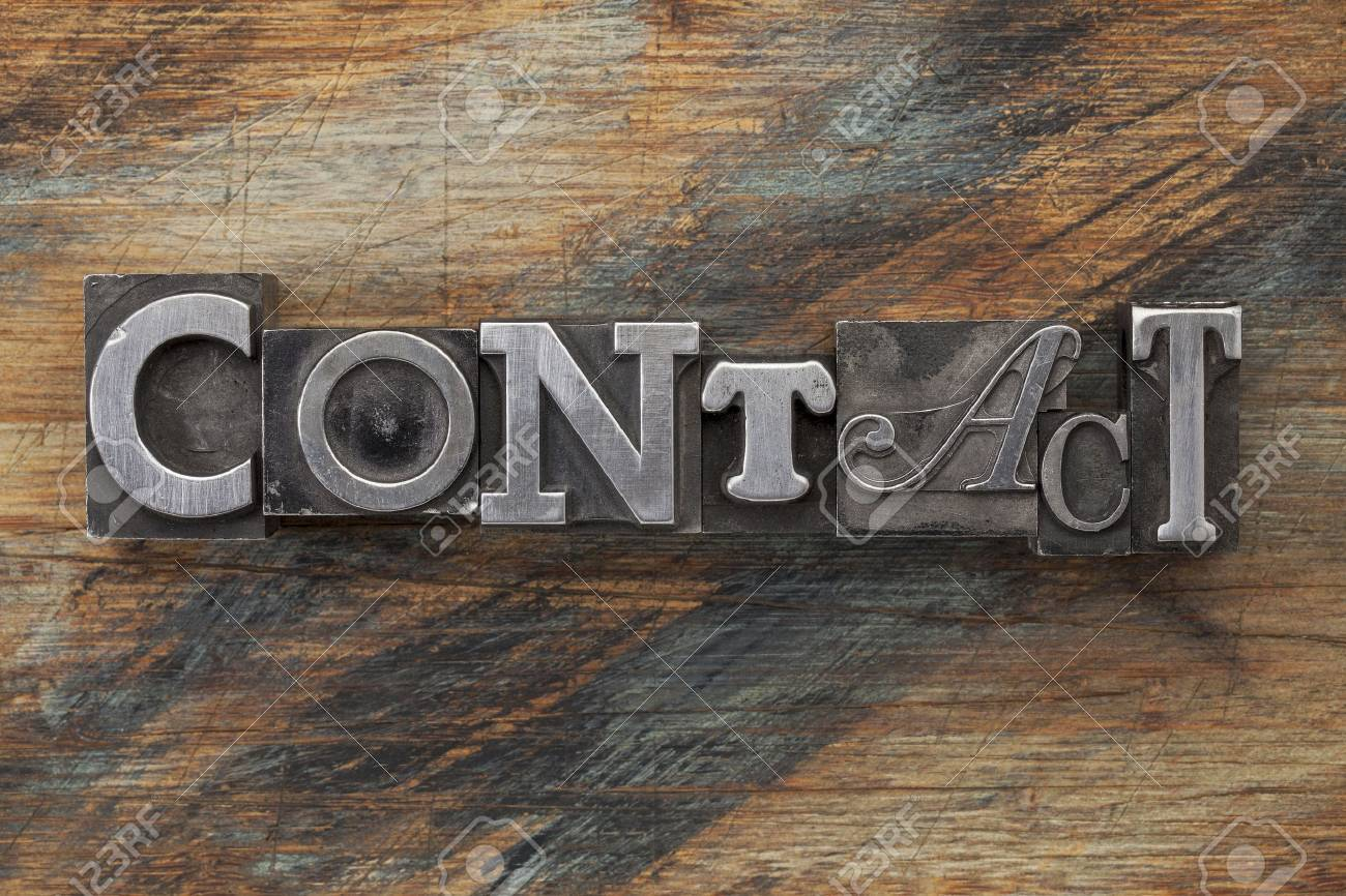 contact word in vintage metal letterpress  type on a grunge painted wood background Stock Photo - 16878509