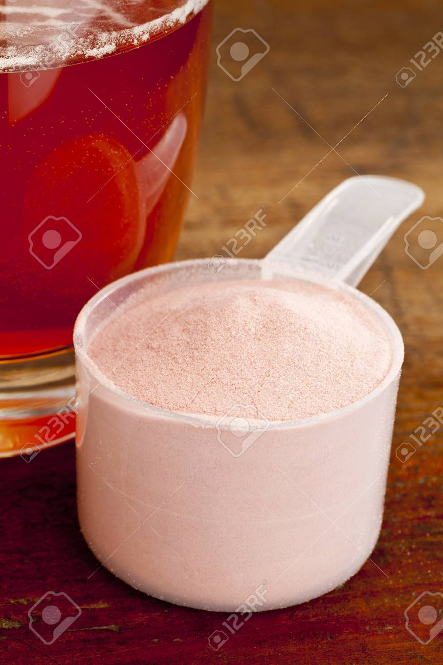 measuring scoop of pomegranate fruit powder and glass of juice Stock Photo - 16878506