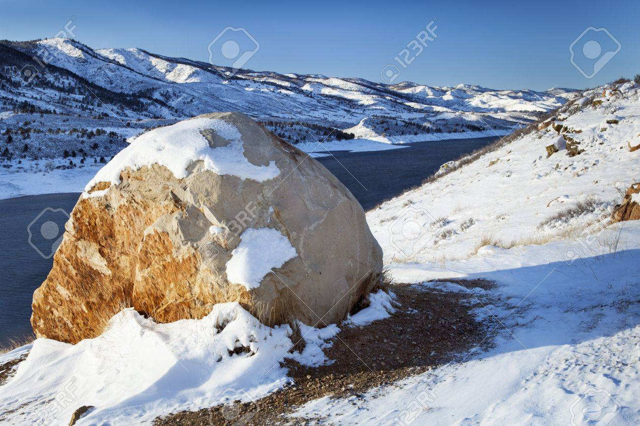 sandstone boulder and Horsetooth Reservoir near Fort Collins, Colorado, winter scenery Stock Photo - 16965015