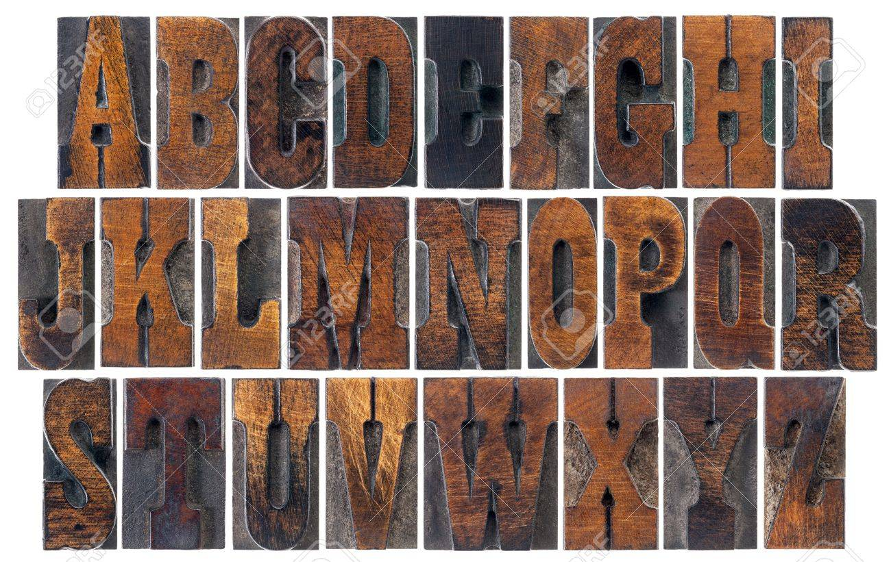 alphabet in vintage letterpress wood type blocks, French Clarendon font popular in western movies and memorabilia, a collage of 26 isolated letters Stock Photo - 18517368
