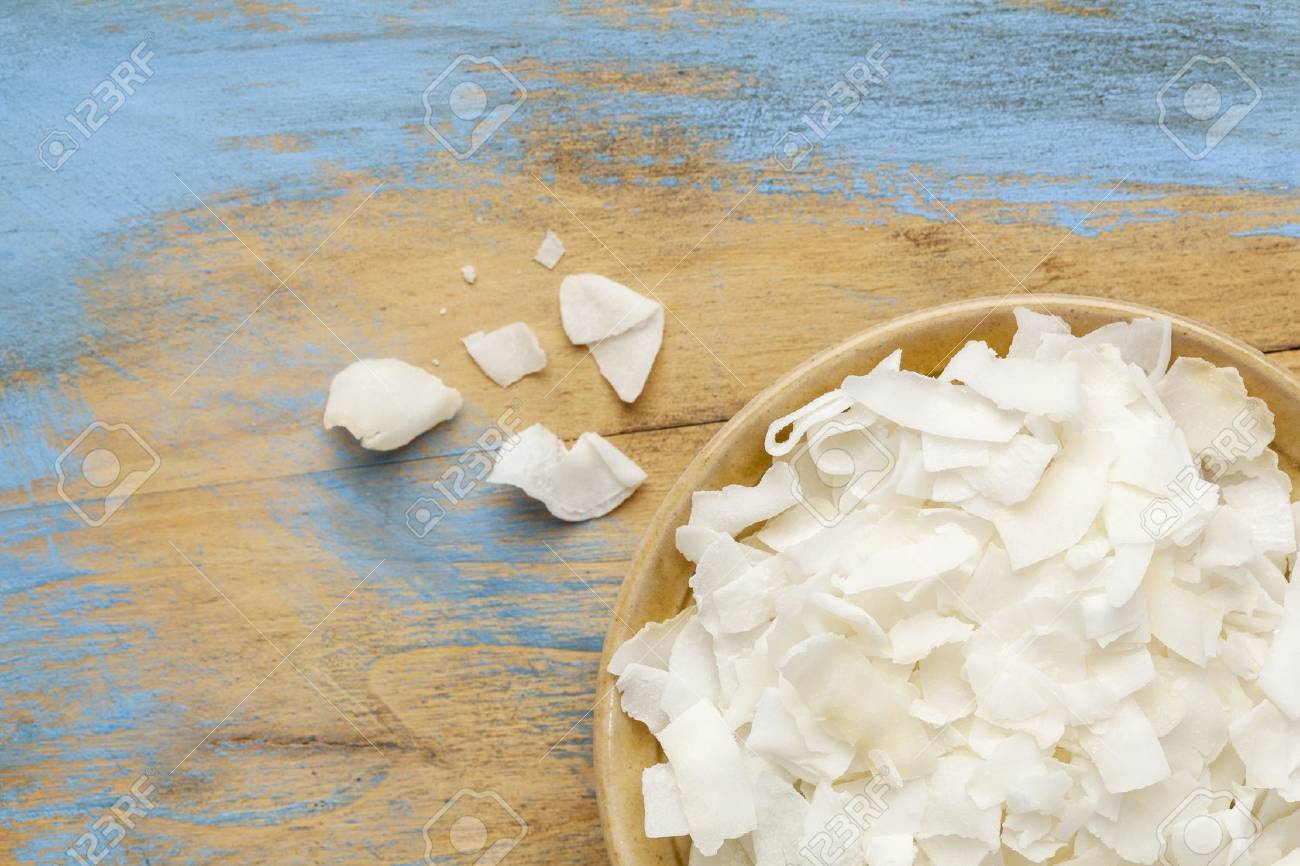 flakes of shredded coconut in a small ceramic bowls against  grunge wooden background, copy space Stock Photo - 18792210