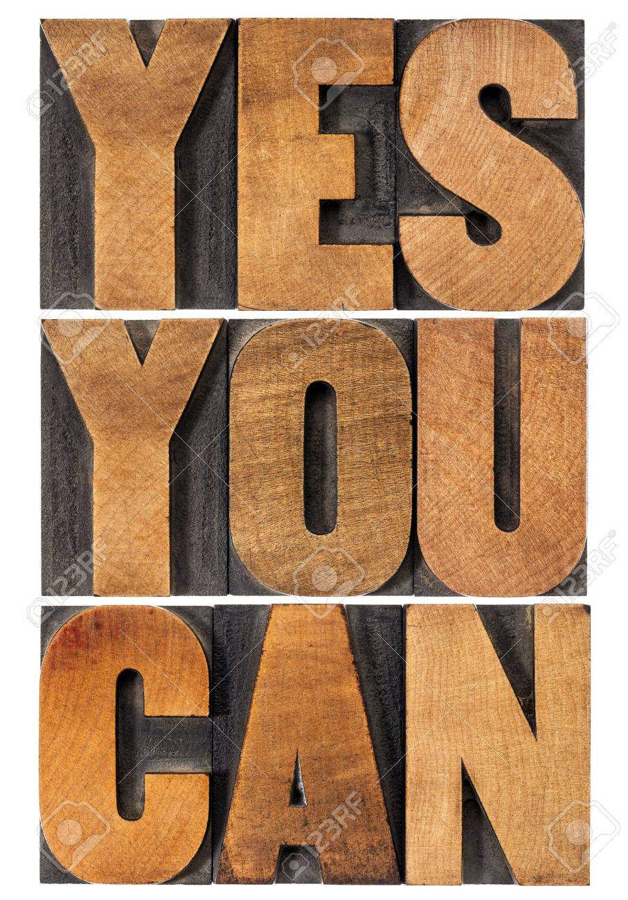 Yes you can - motivational slogan - isolated text in vintage letterpress wood type printing block, rectangular layout Stock Photo - 18942674