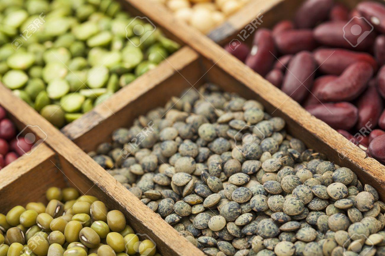 legumes in box abstract with a selective focus on French green lentils, shallow depth of field Stock Photo - 19019505